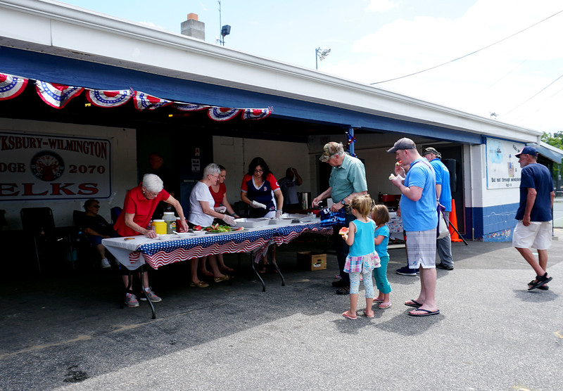People getting their hot dogs at the Livingston Street Recreation Center in Tewksbury during the annual 4th of July events. (The Sun / Chris Tierney)