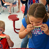 Gavin and Emma Pavao of Westford competing during the 10 and under watermelon eating contest at the Livingston Street Recreatinal Center during the annual 4th of July celebration. (The Sun / Chris Tierney)