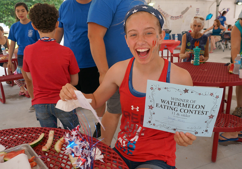 16 year old Devyn Veits is the winner of the 11 and older watermelon eating contest at the Livingston Street Recreational Center during the annual 4th of July events.  (The Sun / Chris Tierney)