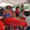 A group of kids admire the slices of melon just before the ten and under watermelon eating contest at the Livingston Street Recreational Center during the annual 4th of July events. (The Sun / Chris Tierney)