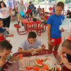 Community Service Department employee Emily Walker looks on as Jermermy Perez age 13 of Tewksbury, Jack Callahan age 12 of Tewksbury, and Ashley Bowdin age 11 of Methuen compete during the 11 and older watermelon eating contest at the Livingston Street Recrreation Center in Tewksbury during the annual 4th of July events. (The Sun / Chris Tierney)