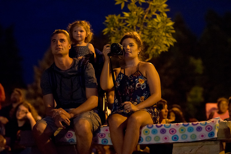Jordan Queen, Kyleigh Queen, and Schae Queen sit and watch fireworks on the shores of Lake Loveland on July 4, 2016. Jordan has brought both Kyleigh and Schae for the first time to see the show in Loveland.<br /> <br /> Photo by Michael Ortiz/ Loveland Reporter-Herald