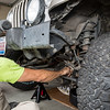 Steve Baskis removing bolts from the front differential of his 2003 Jeep Wrangler Rubicon.