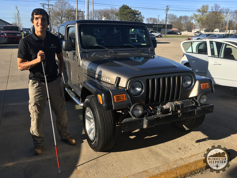 Steve Baskis standing next to his newly aquired 2003 Jeep Wrangle Rubicon