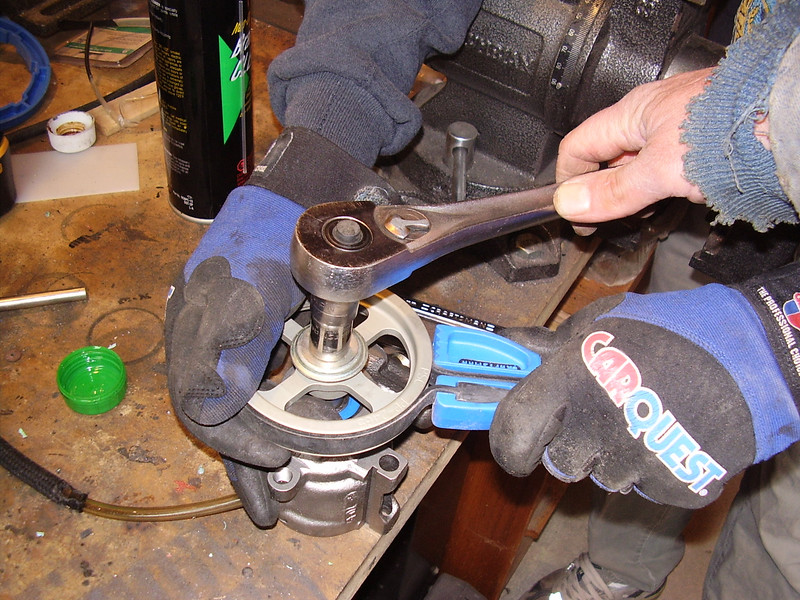 Pressing the pulley onto the pump.