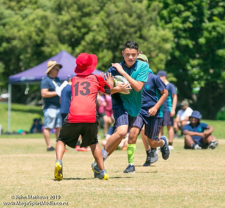 Images of the game between Point England (red) and St Thomas (blue) at the Eastern Zone Touch Tournament for boys, girls and mixed grades held at Madills Farm, Kohimarama, Auckland on 5 November 2019. Copyright: John Mathews 2019.