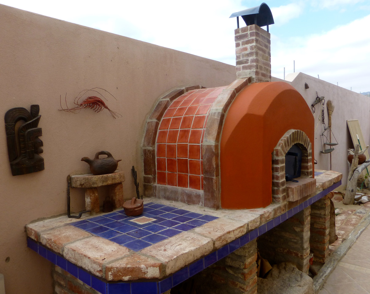 I almost never eat pizza. So why design and spend a hundred hours  hand building my own pizza oven? Well I just had a vision of something different and there are windless spells even in La Ventana. So.....