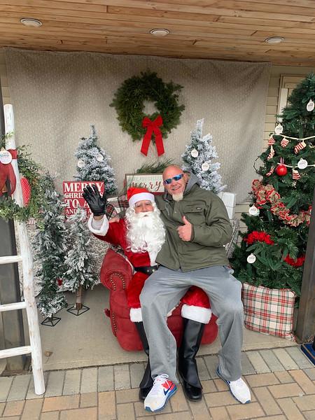 Steve Chamberland of Tampa, Fla., a Dracut native and founder of 50 Legs, tells Santa what he wants.