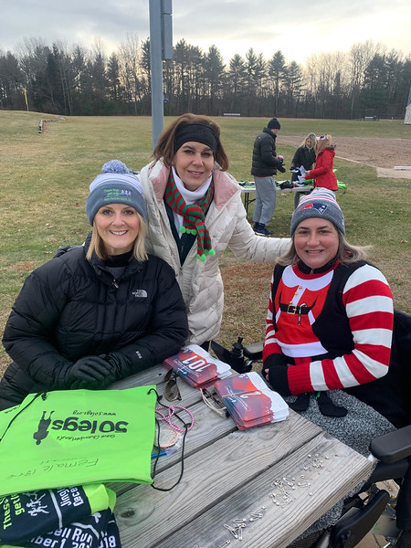 50 Legs beauties, from left, Christine Hart of Westford, with sisters Carmen Acabbo of Westford, 50 Legs chair, and Boston Marathon bombing survivor Celeste Corcoran of Dracut