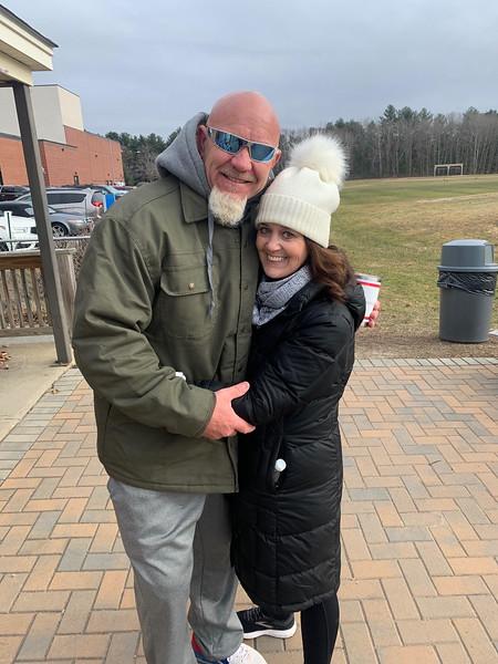 50 Legs founder Steve Chamberland of Tampa, Fla., hugs good friend Christine Liva Smith of Westford
