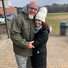 50 Legs founder Steve Chamberland of Tampa, Fla., hugs good friend Christine Liva Smith of Westford