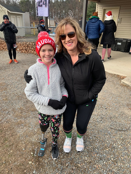 Samantha Eddington of Georgetown, Ky., and her daughter Katie, a 50 Legs prosthetic recipient