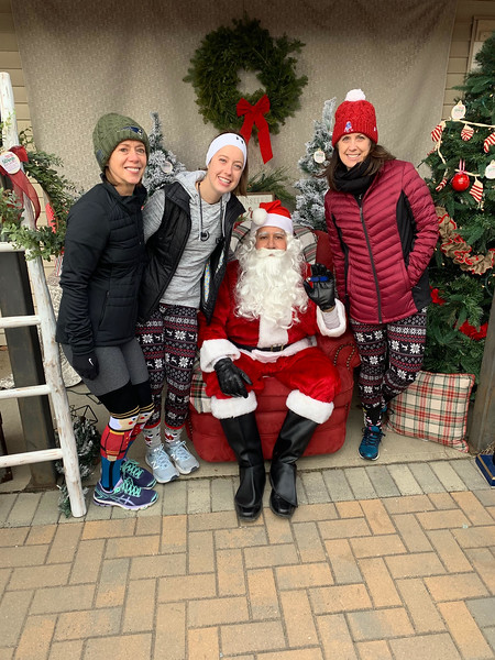 Santa with, from left, Mary Morgan, and Tara and Julie Daly, all of Pepperell.