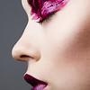 Studio portrait of beautyful woman with creative make-up