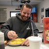 The 50/50 Diner in Fitchburg has just turned 20 years old and the owners sat down to talk about it on Thursday, Jan. 23, 2020. Enjoying some scrambled eggs with cheese is Scott Cunningham. SENTINEL & ENTERPRISE/JOHN LOVE