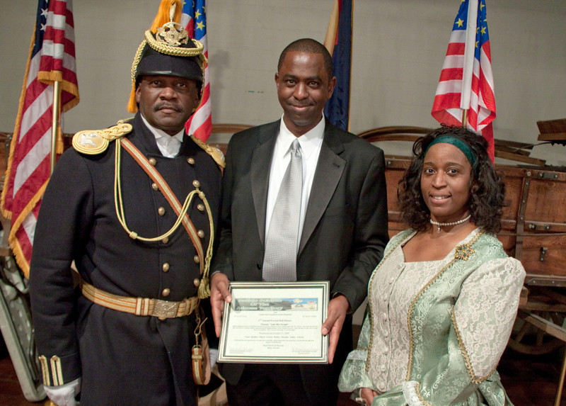 Commander Fred Marable (l) and PVT Michelle London Marable (r) present a Certificate of Appreciation to Paradise Valley Mayor Vernon B. Parker (c).