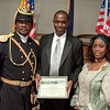 Commander Fred Marable, (l) and  Pvt. Michelle London Marable (r) present a Certificate of Appreciation to Paradise Valley Mayor Vernon B. Parker (c).