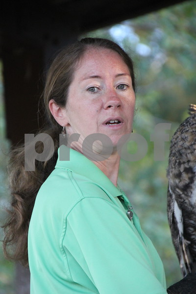 Pictured here is SOAR handler and volunteer, Laura Zaugg educating the attendees about a great horned owl named Stella, who is one of a few of the raptors that were part of the raptors education, which was just another one of many activities for families attending the 50th Celebration for Kennedy Park and Trail held on Sunday, October 11, 2015. The event took place at Kennedy Park in Fort Dodge.