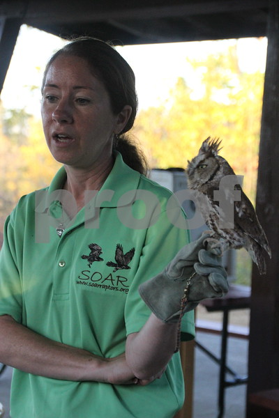 Pictured here is SOAR handler and volunteer, Laura Zaugg and a screech owl named Cedar, who is one of a few of the raptors that were part of the raptors education, which was just another one of many activities for families attending the 50th Celebration for Kennedy Park and Trail held on Sunday, October 11, 2015. The event took place at Kennedy Park in Fort Dodge.<br /> add keywords