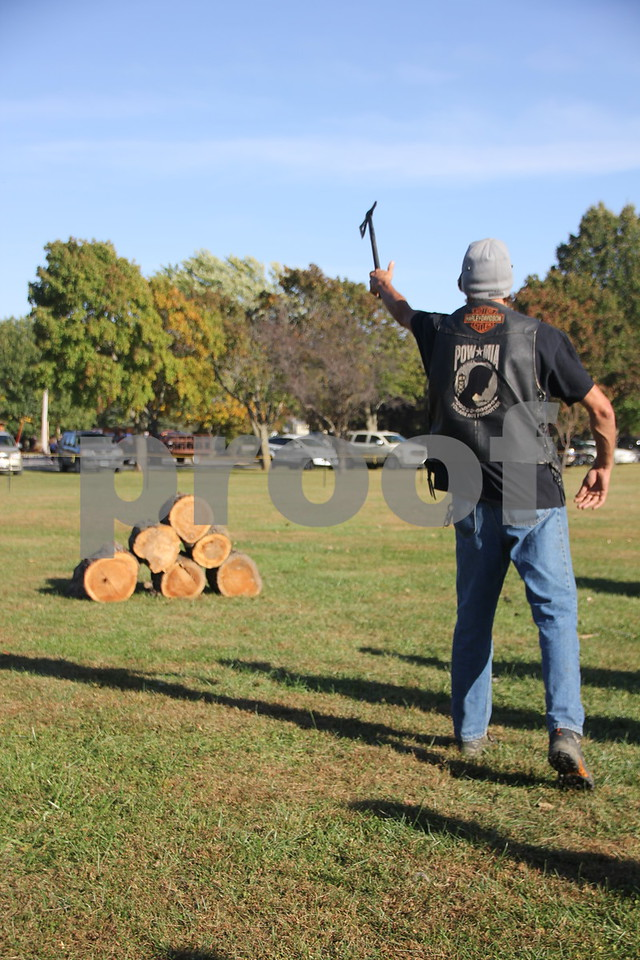 Seen here is: Monte Anderson, from Dayton, trying his luck at  throwing a tomahawk,  just one of many activities for families attending the 50th Celebration for Kennedy Park and Trail held on Sunday, October 11, 2015. The event took place at Kennedy Park in Fort Dodge.