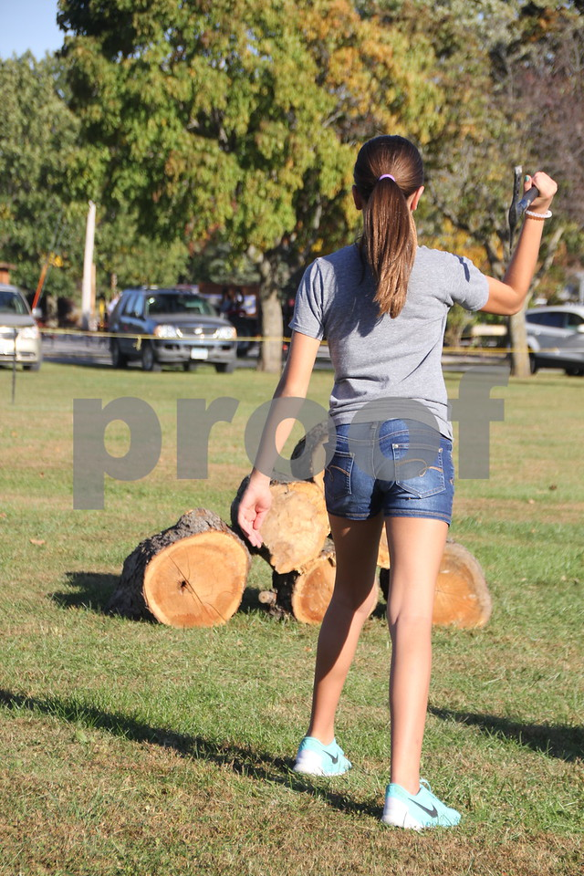 Katie Flaherty is pictured  trying her luck at throwing a tomahawk, just one of many activities for families attending the 50th Celebration for Kennedy Park and Trail held on Sunday, October 11, 2015. The event took place at Kennedy Park in Fort Dodge.