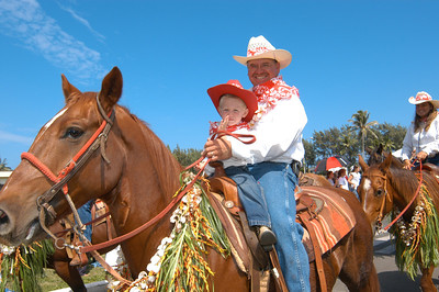 Greg Smith and daughter, from Gunstock Ranch, ride in the community parade