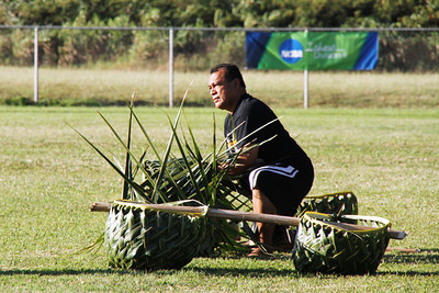 Steve Laulu gets the coconut relay ready for the PCC Sports Festival; Polynesian Cultural Center photo by Mike Foley