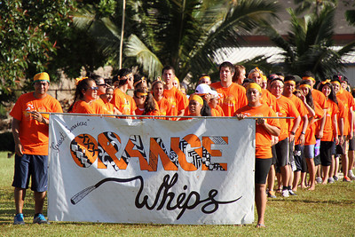 "Guest Services ""Orange Whips,"" lining up for the parade in the PCC Sports Festival; Polynesian Cultural Center photo by Mike Foley"