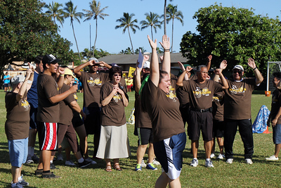 Admin-guys, lining up for the parade in the PCC Sports Festival; Polynesian Cultural Center photo by Mike Foley