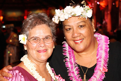 60s alumnae Sally Ann McShane Foley (left) and Rhonda Carruthers Andreasen at the Golden Jubilee Ball; Polynesian Cultural Center photo by Mike Foley