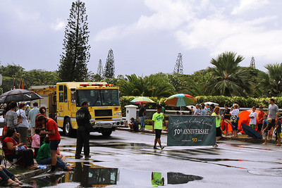 The Kahuku Fire Department truck leads the parade, just in case they have to leave for an emergency; Polynesian Cultural Center photo by Mike Foley