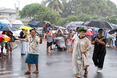 Hawaiian Village representatives... also not afraid of a little rain; Polynesian Cultural Center photo by Mike Foley