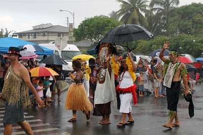 PCC village representatives . . .rain or shine; Polynesian Cultural Center photo by Mike Foley