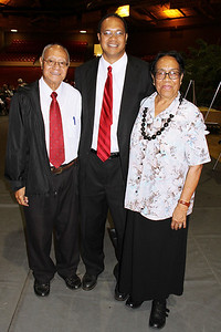 Laie 6th Ward Bishop Tevita Ka'ili (center) and his parents . . . after the testimony meeting; Polynesian Cultural Center photo by Mike Foley