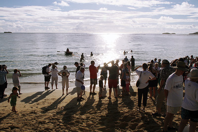 The Laie Community Association (LCA) put on a special Hawaiian hukilau in honor of the PCC 50th Anniversary celebration the morning of Friday, September 6, at Hukilau Beach, starting with an explanation and a rowboat laying the net in a large semi-circle out in the bay; Polynesian Cultural Center photo by Mike Foley