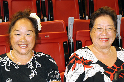 Gladys Chu Kalama (right) and her sister wait for the musical fireside to start; (Polynesian Cultural Center photo by Mike Foley)