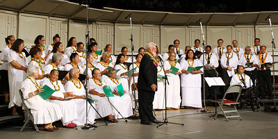 Former Hawaiian Village chief Joe Ah Quin leads the Hawaiian choir in the PCC 50th Anniversary musical fireside; (Polynesian Cultural Center photo by Mike Foley)