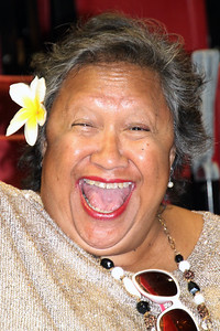 A huge smile from Fia Memea, while waiting for the musical fireside; (Polynesian Cultural Center photo by Mike Foley)