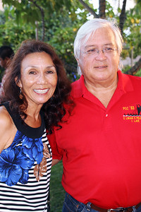 Original '63 PCC employees Sandy Kawelo Bassett (left) and Jimmy Bassett: he had special polo shirts made up for the'63 alumni; Polynesian Cultural Center photo by Mike Foley