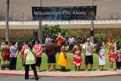 """Hawaiian Village """"chief"""" Raymond Mokiao blows the conch shell, signaling the beginning of the flagraising ceremony; (Polynesian Cultural Center photo by Mike Foley)"""