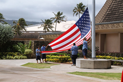 PCC Security officers raise the U.S. flag during the September 2, 2013, flagraising ceremony; (Polynesian Cultural Center photo by Mike Foley)