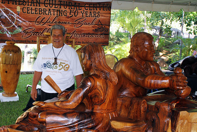 PCC labor missionary, alumnus and master carver Tuione Pulotu exhibits some of his creations in the Island craft fair (although his were not for sale); Polynesian Cultural Center photo by Mike Foley