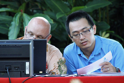 MIS' Allen Kroff (left) and Edward Wong tally the 50th Anniversary golf tournament scorecards; Polynesian Cultural Center photo by Mike Foley