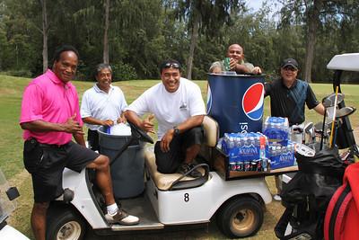 Taking a break during the PCC 50th golf tournament (left-right): Atunaisa Laqeretabua, _____, Misi Fiu, Jerome Lomu and Bob Owan; Polynesian Cultural Center photo by Mike Foley