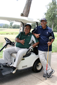 PCC past and present golfers (right-left, respectively) Iameli Kaio and Fasi Tovo . . . in the 50th Anniversary tournament at Turtle Bay Resort; Polynesian Cultural Center photo by Mike Foley