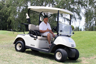 Photo Polynesia's Spencer Kamauoha . . . covering the 50th Anniversary golf tournament at Turtle Bay Resort; Polynesian Cultural Center photo by Mike Foley
