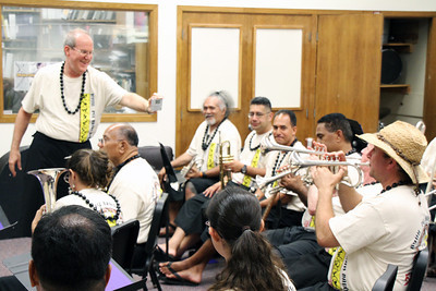 PCC/BYUH Alumni Brass Band practice, (David Kammerer helping tune up); Polynesian Cultural Center photo by Mike Foley