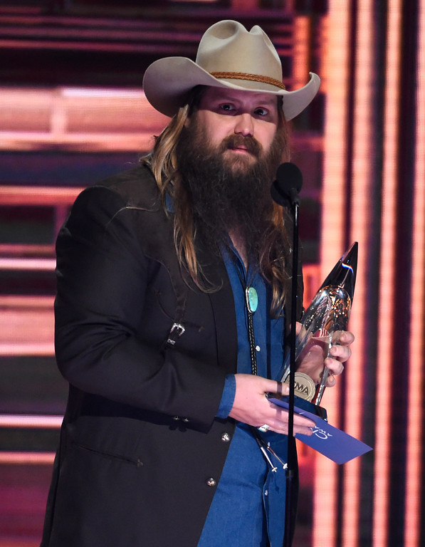 ". Chris Stapleton accepts the award for album of the year ""From A Room: Volume 1\"" at the 51st annual CMA Awards at the Bridgestone Arena on Wednesday, Nov. 8, 2017, in Nashville, Tenn. (Photo by Chris Pizzello/Invision/AP)"