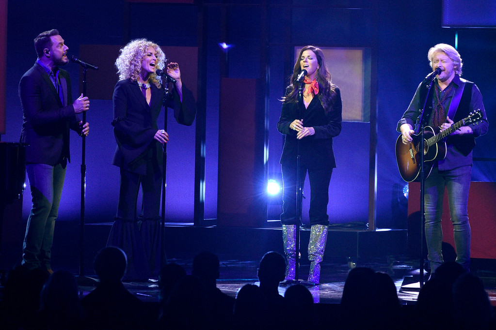 ". Jimi Westbrook, from left, Kimberly Schlapman, Karen Fairchild and Philip Sweet, of Little Big Town, perform ""Wichita Lineman\""at the 51st annual CMA Awards at the Bridgestone Arena on Wednesday, Nov. 8, 2017, in Nashville, Tenn. (Photo by Chris Pizzello/Invision/AP)"