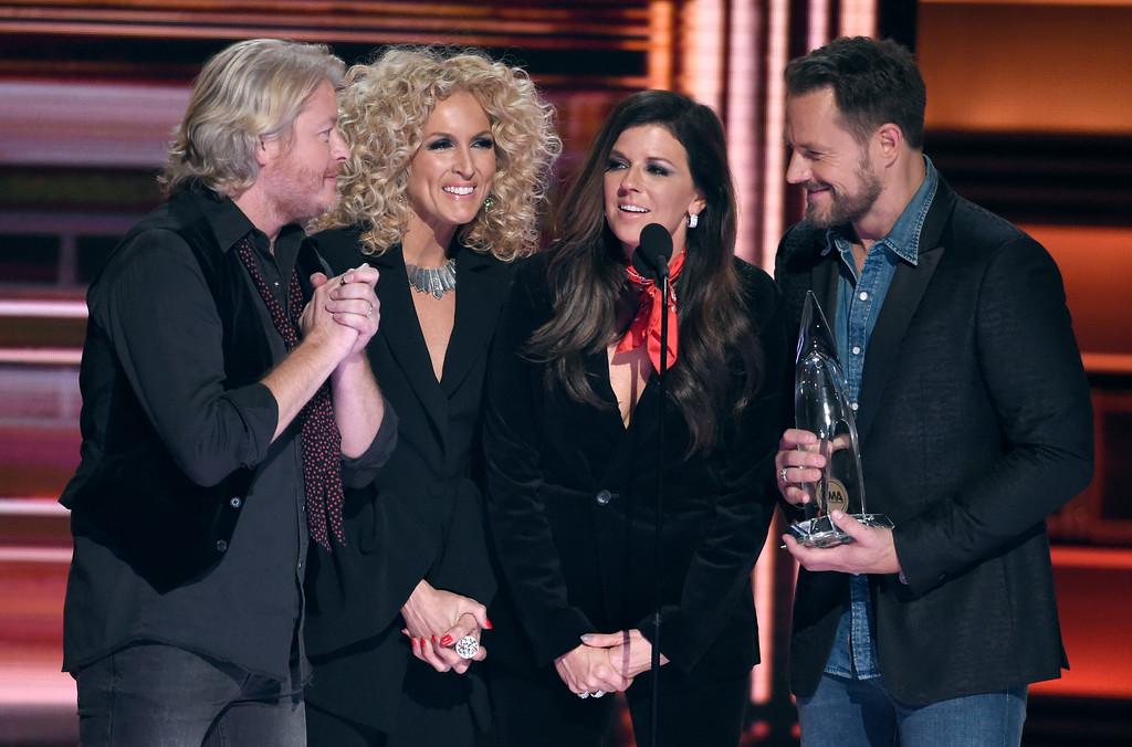 . Philip Sweet, from left, Kimberly Schlapman, Karen Fairchild and Jimi Westbrook, of Little Big Town, accept the award for vocal group of the year at the 51st annual CMA Awards at the Bridgestone Arena on Wednesday, Nov. 8, 2017, in Nashville, Tenn. (Photo by Chris Pizzello/Invision/AP)